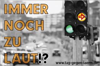 Grüne Ampel vor Straße, zusammen mit dem Motto des Aktionstags: Immer noch zu laut?!